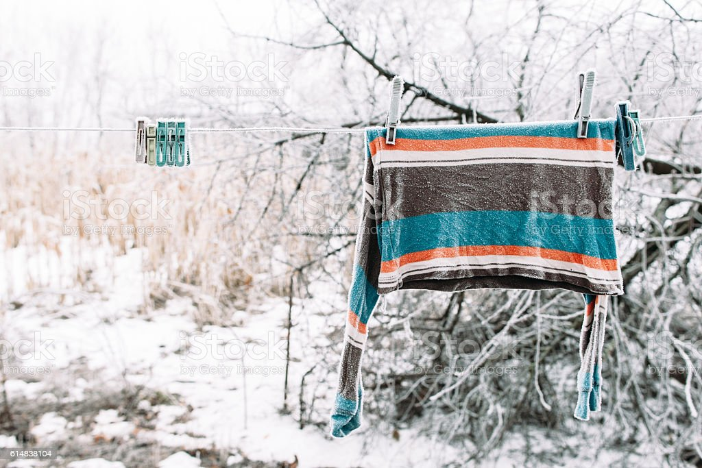 Frozen pullover on clothesline outside stock photo