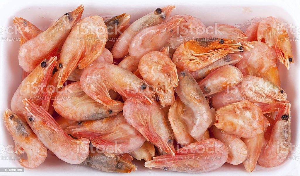 Frozen red shrimps in white plastic box stock photo