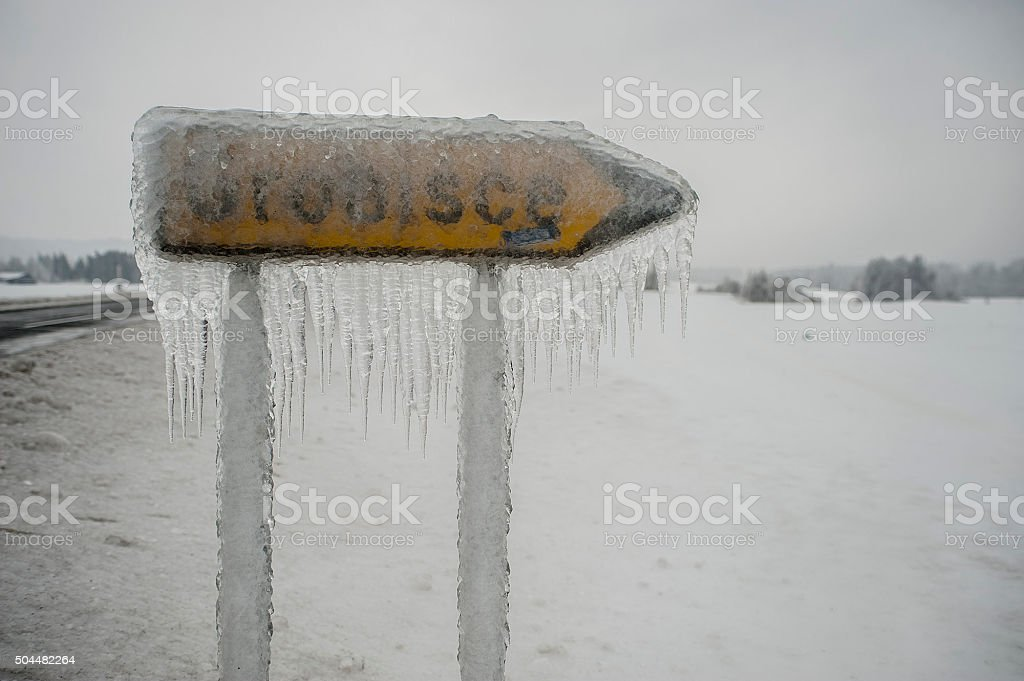 frozen road sign stock photo