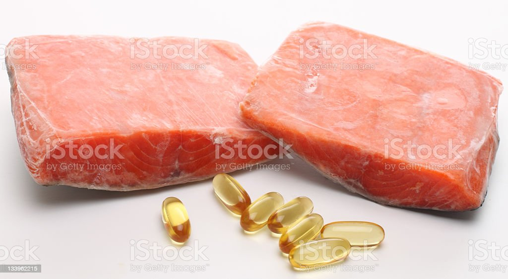 Frozen Salmon and fish oil pills royalty-free stock photo