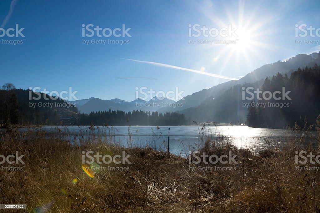 Frozen Schwarzsee, Kitzbuehel with sunlight stock photo