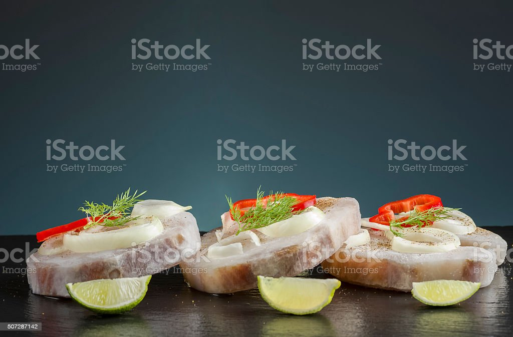 frozen shark steaks with vegetables ready to cook stock photo