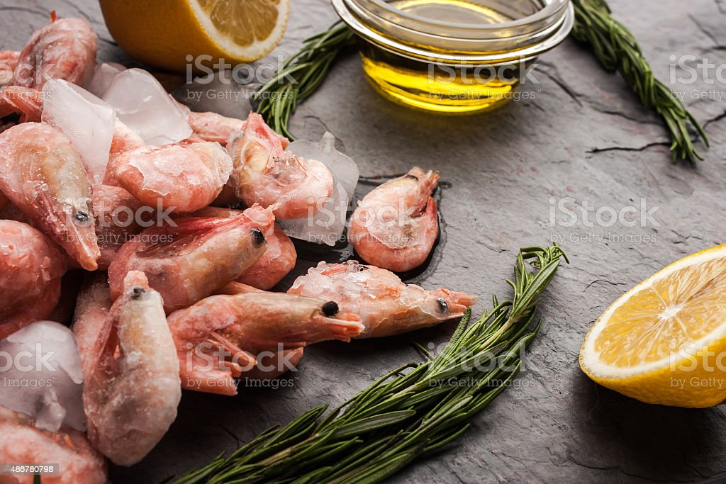 Frozen shrimps  with rosemary, lemon and olive oil stock photo