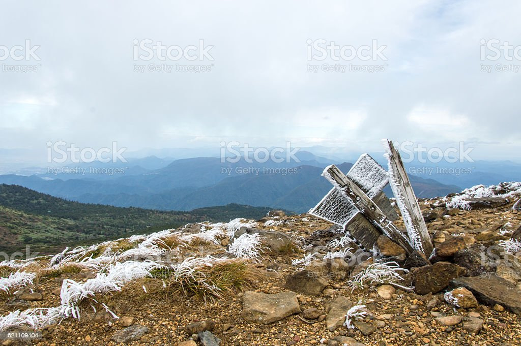 Frozen sign, grass and rocks on a mountain, Japan stock photo