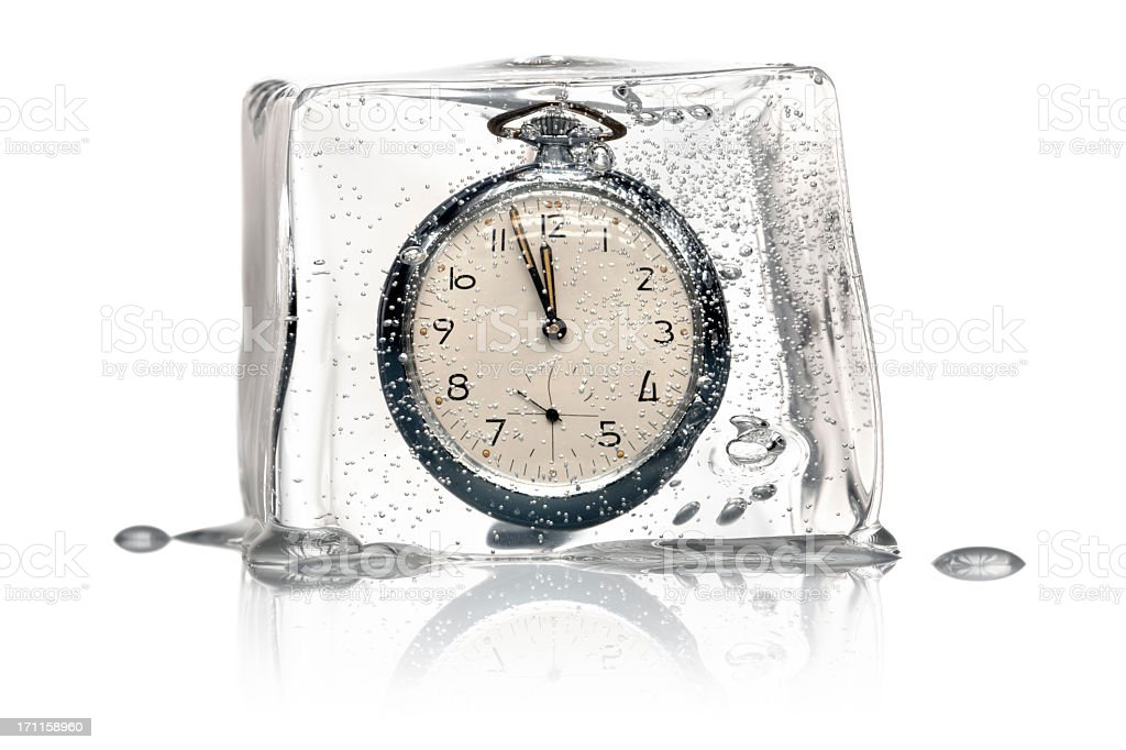 Frozen Time Concept - Clock Ice Cube retro stock photo
