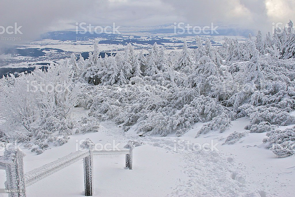 Frozen trail railing in snow covered mountains. royalty-free stock photo