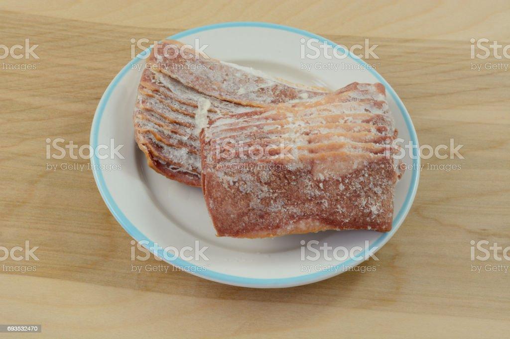 Frozen turkey bacon stock photo