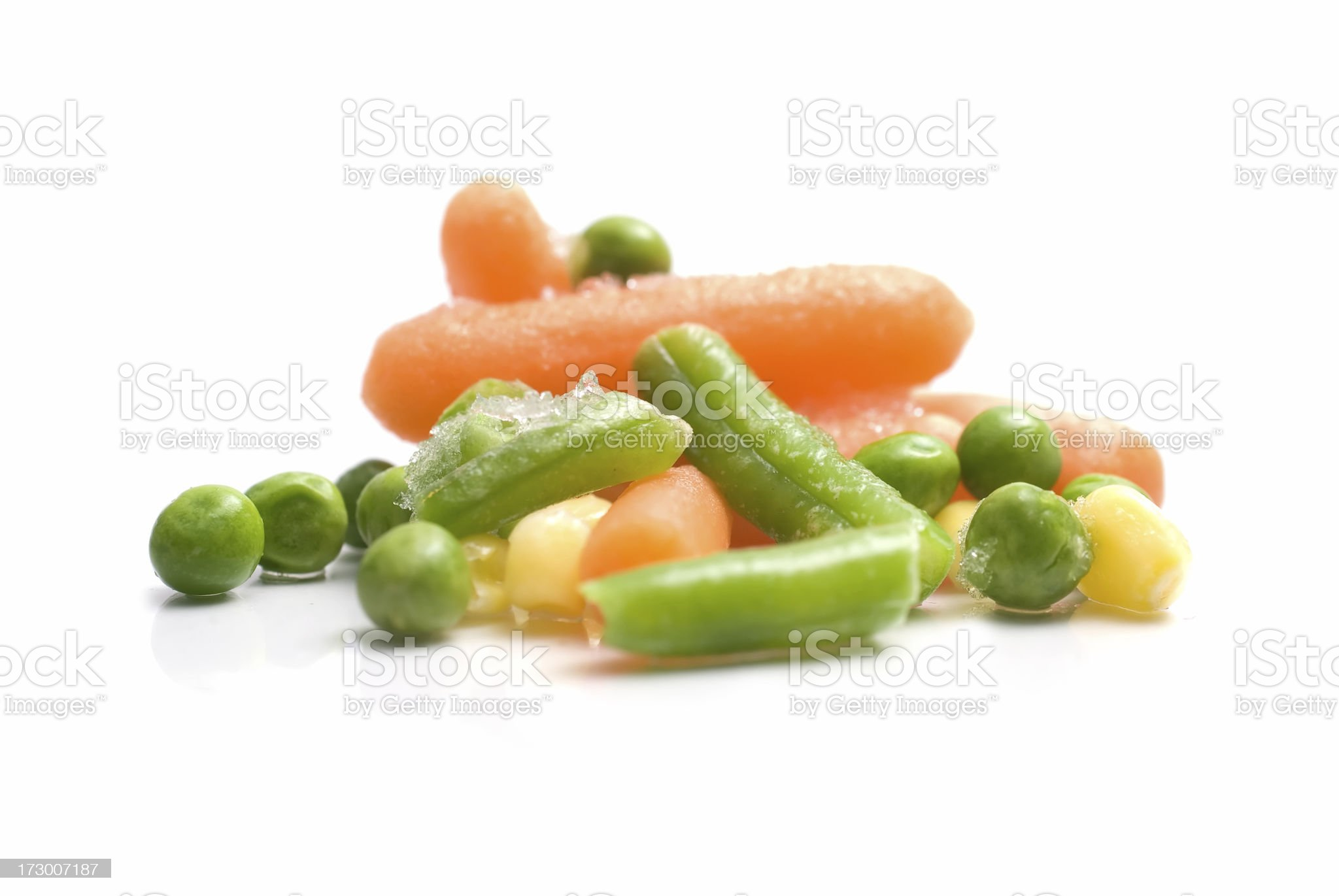 Frozen vegetables against a white backgorund royalty-free stock photo