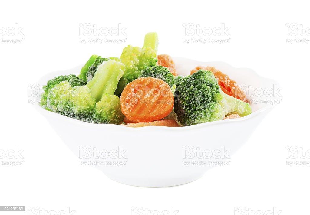 Frozen vegetables in ceramic bowl stock photo