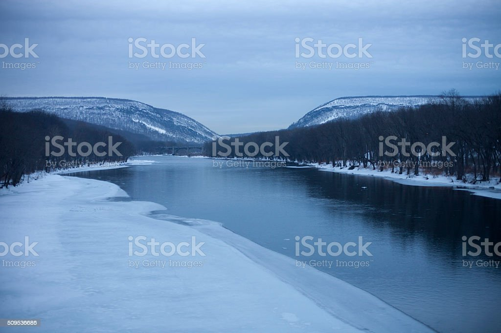 Frozen water at the Delaware River with Delaware Water Gap stock photo
