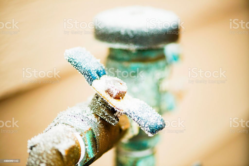 Frozen water shut off handle in snowstorm stock photo