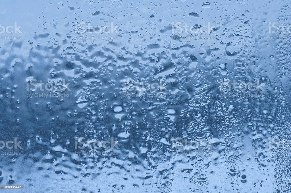 Frozen water-drops on glass royalty-free stock photo