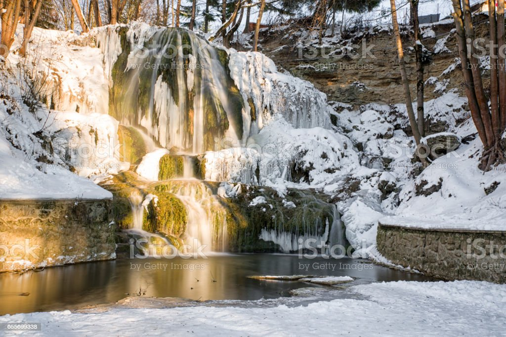 Frozen waterfall in village Lucky, Slovakia stock photo