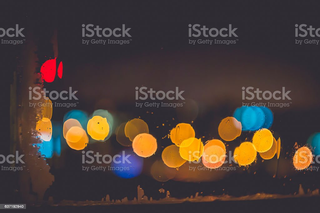 Frozen window with Blurred Defocused light of Night City stock photo