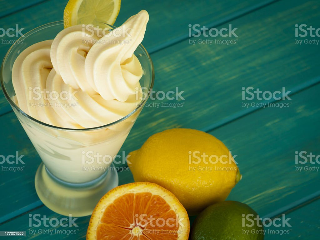 Frozen yogurt in cup by fresh fruit stock photo