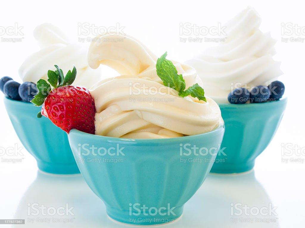 Frozen yogurt with berries in bowls stock photo