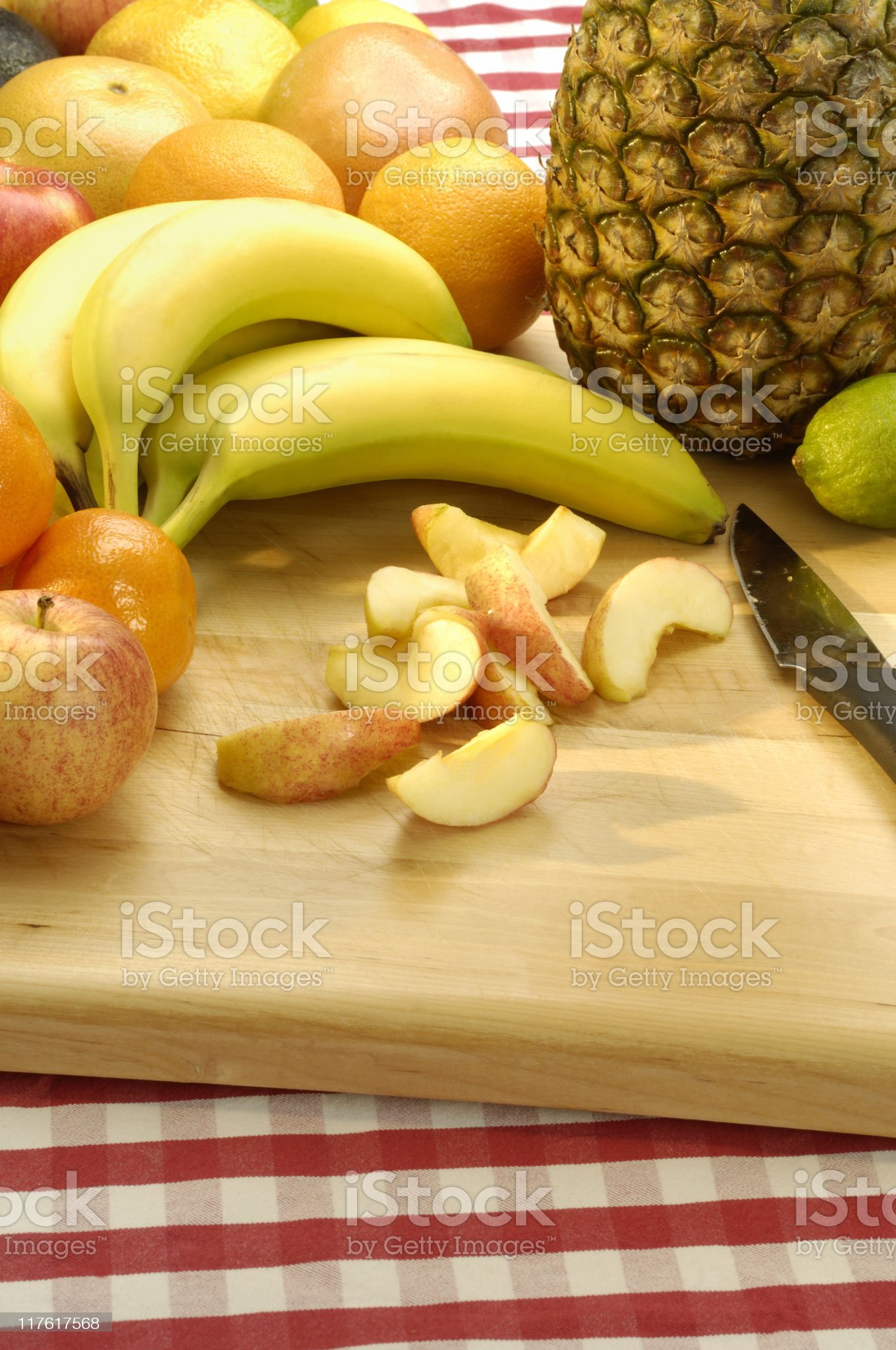 Fruit and a chopping board royalty-free stock photo