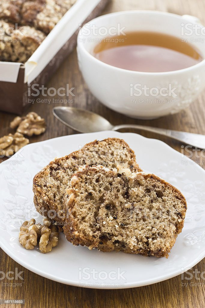Fruit and nut cake with cup of tea stock photo
