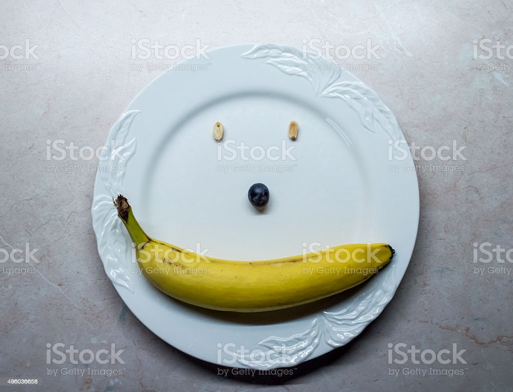 Fruit and Nuts Smiley/Happy Face on a White Plate royalty-free stock photo