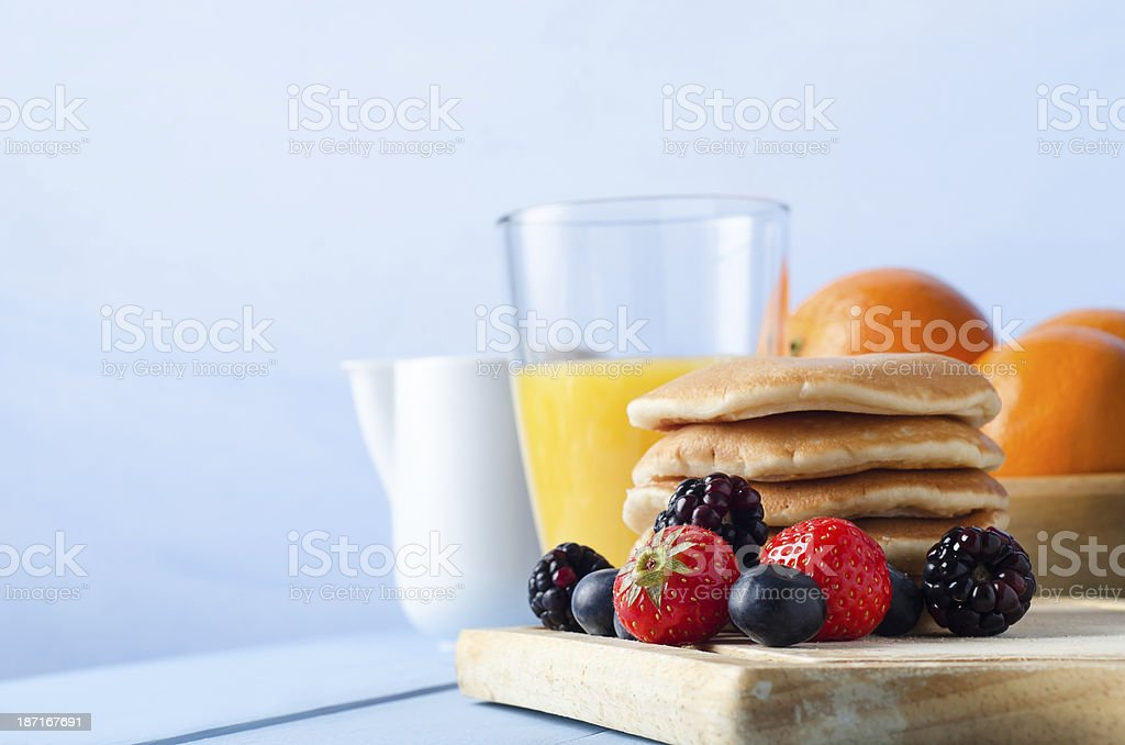 Fruit and Pancakes Breakfast Table stock photo