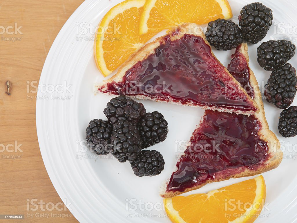 Fruit and toast breakfast stock photo