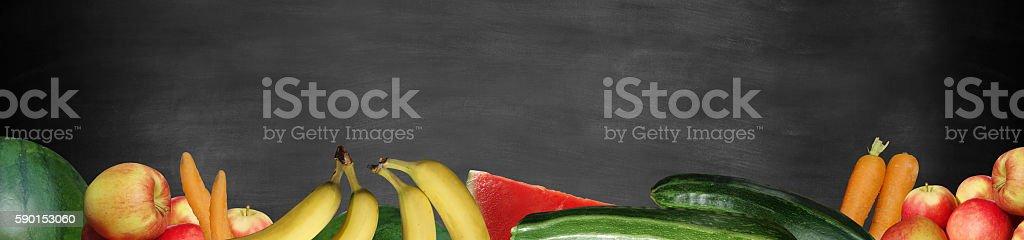 fruit and vegetable on blackboard panorama stock photo