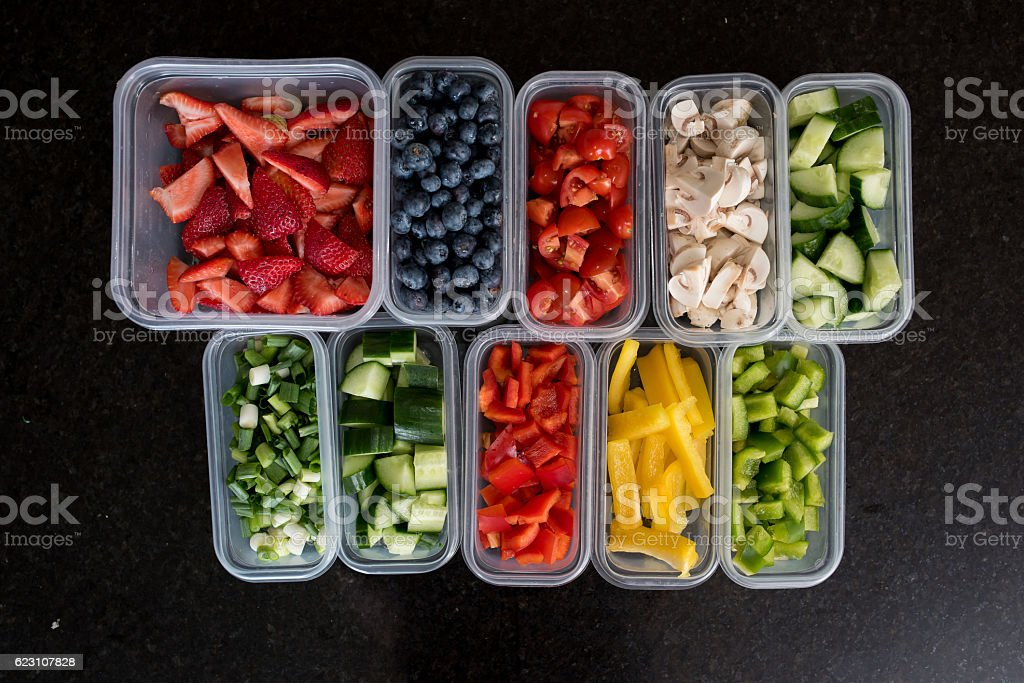 fruit and vegetables in containers stock photo