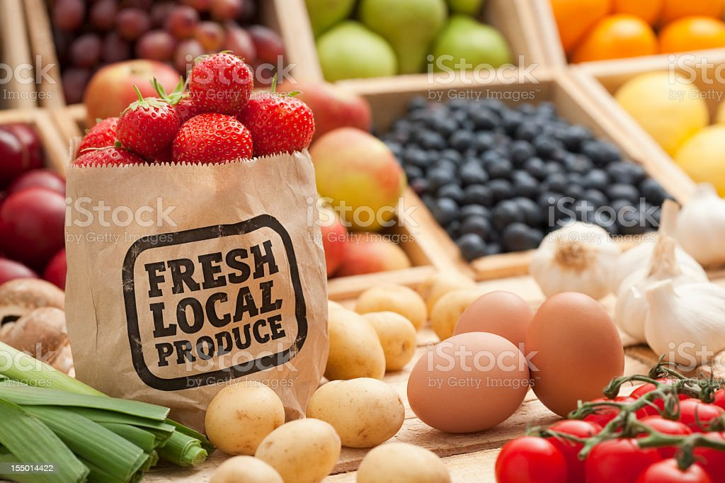 Fruit and vegetables on a counter top stock photo