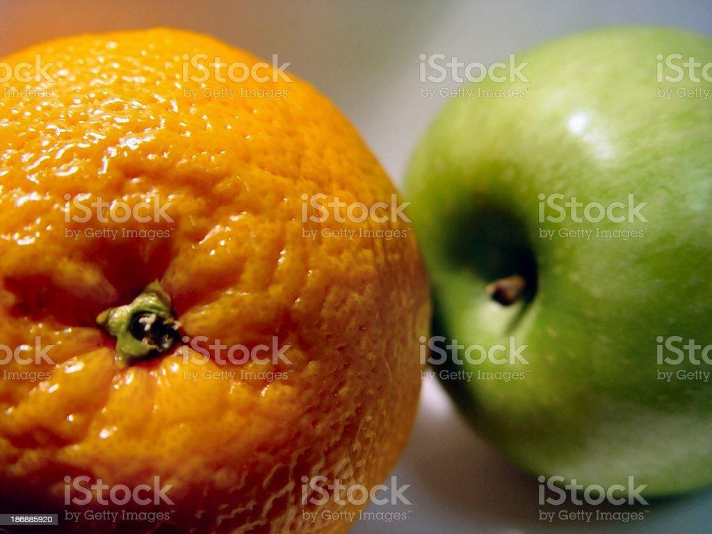 fruit - apple and orange stock photo