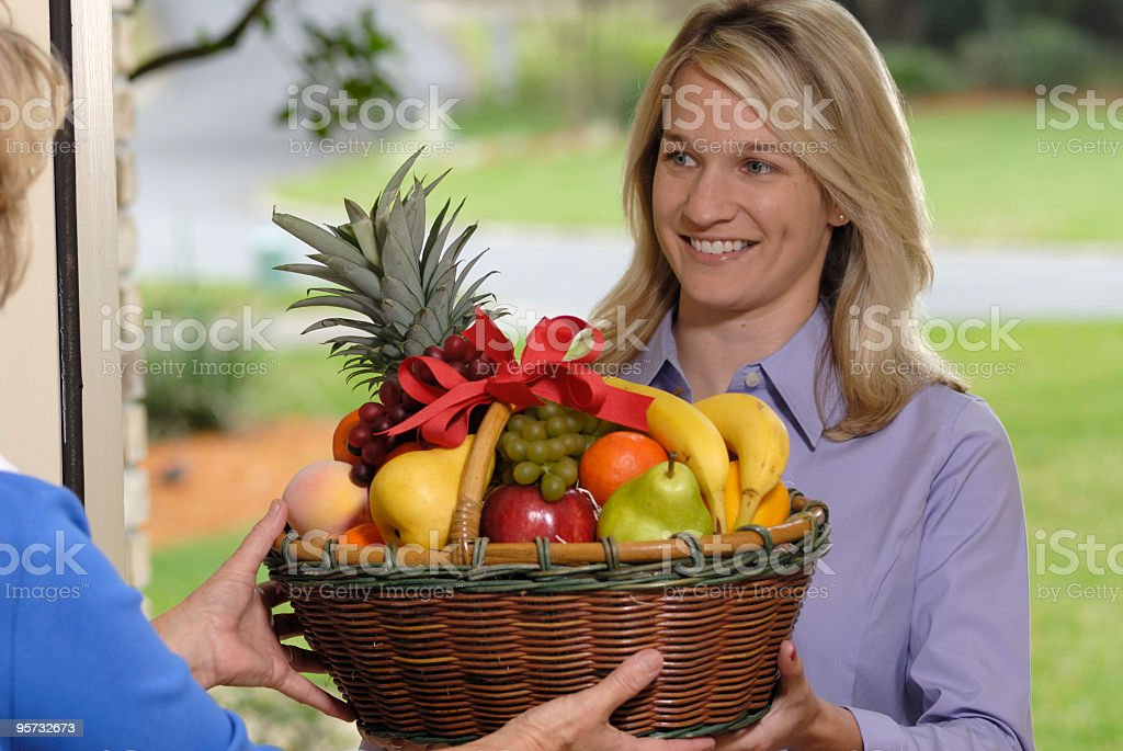 fruit basket delivery stock photo