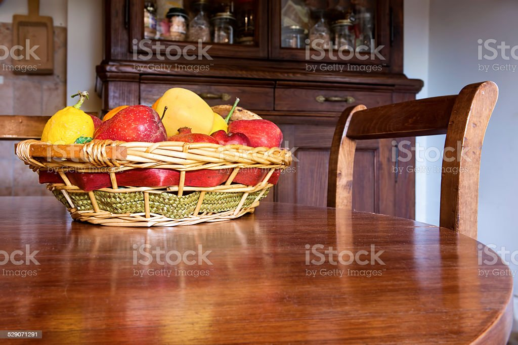 Fruit basket on the table stock photo