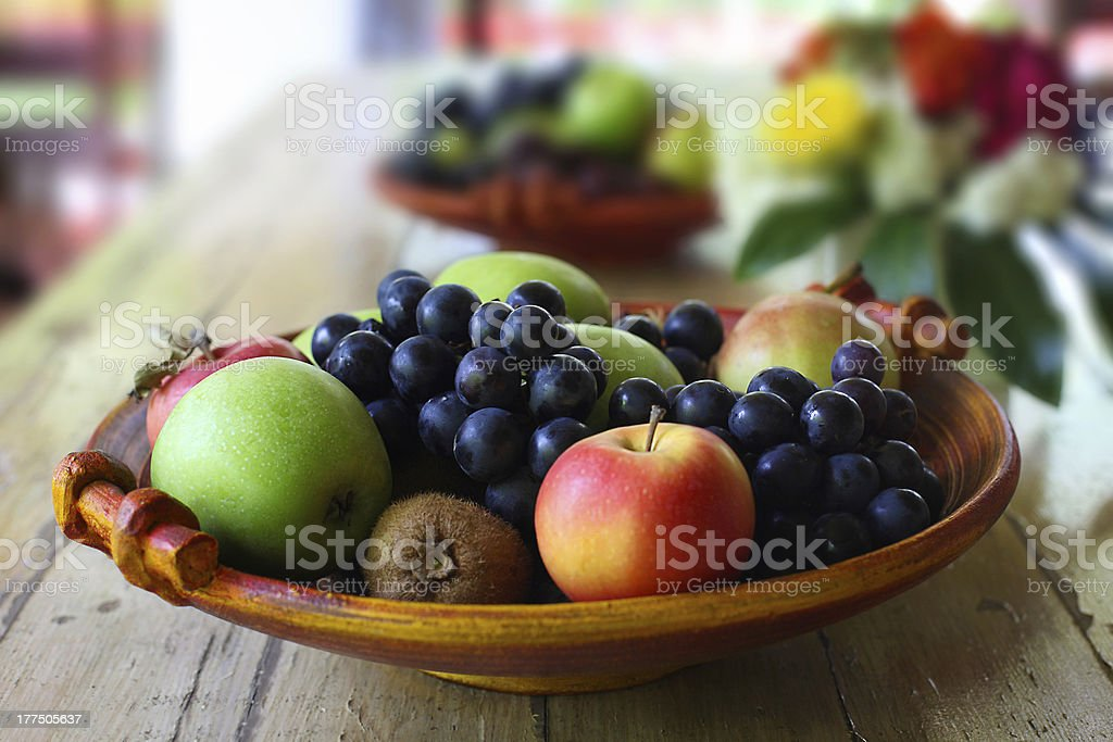 Fruit Basket on Wooden table stock photo