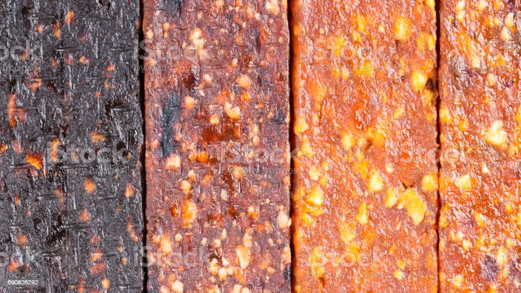 Fruit berry and nut energy bars as a food background. Fruit bars texture. stock photo