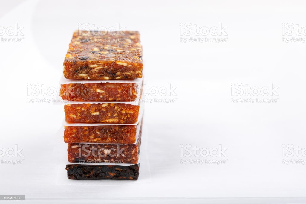 Fruit berry and nut energy bars. Healthy snack. Copy space stock photo