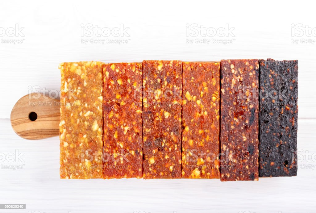 Fruit berry and nut energy bars. Healthy snack. Top view. stock photo