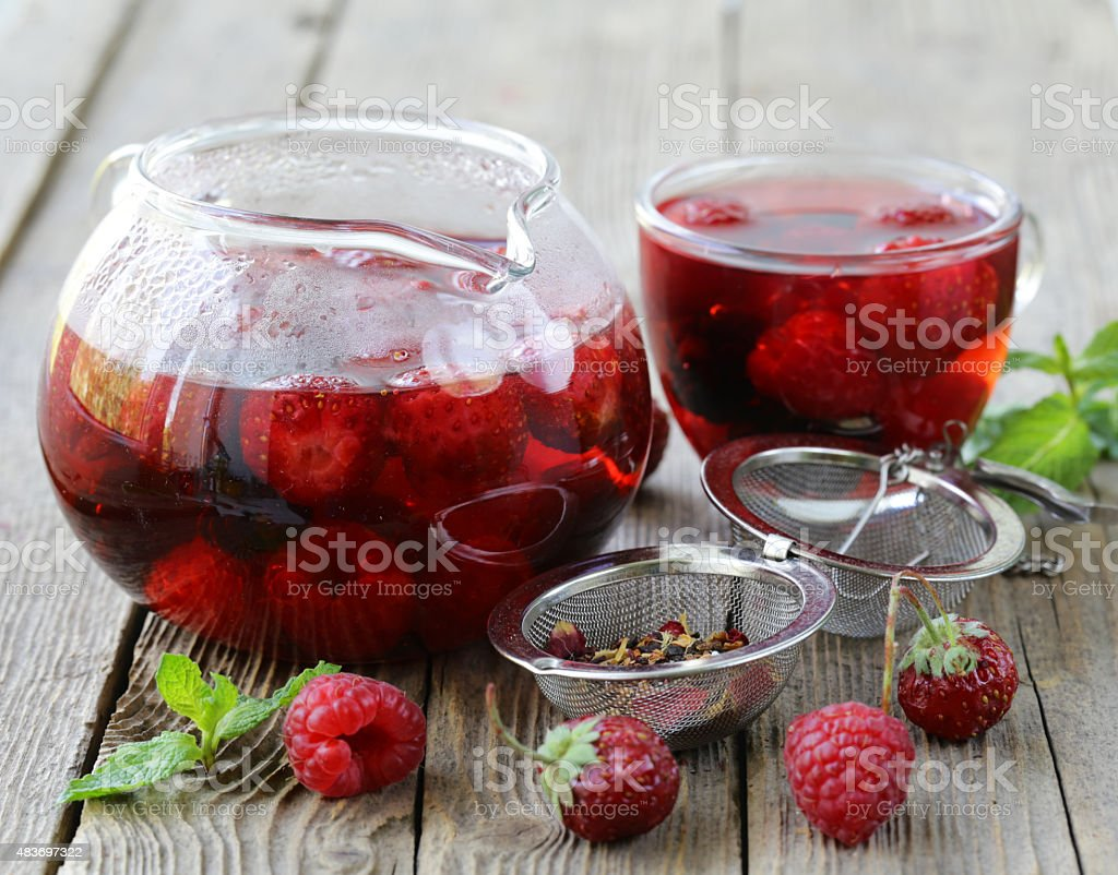 fruit berry red tea on a wooden table stock photo