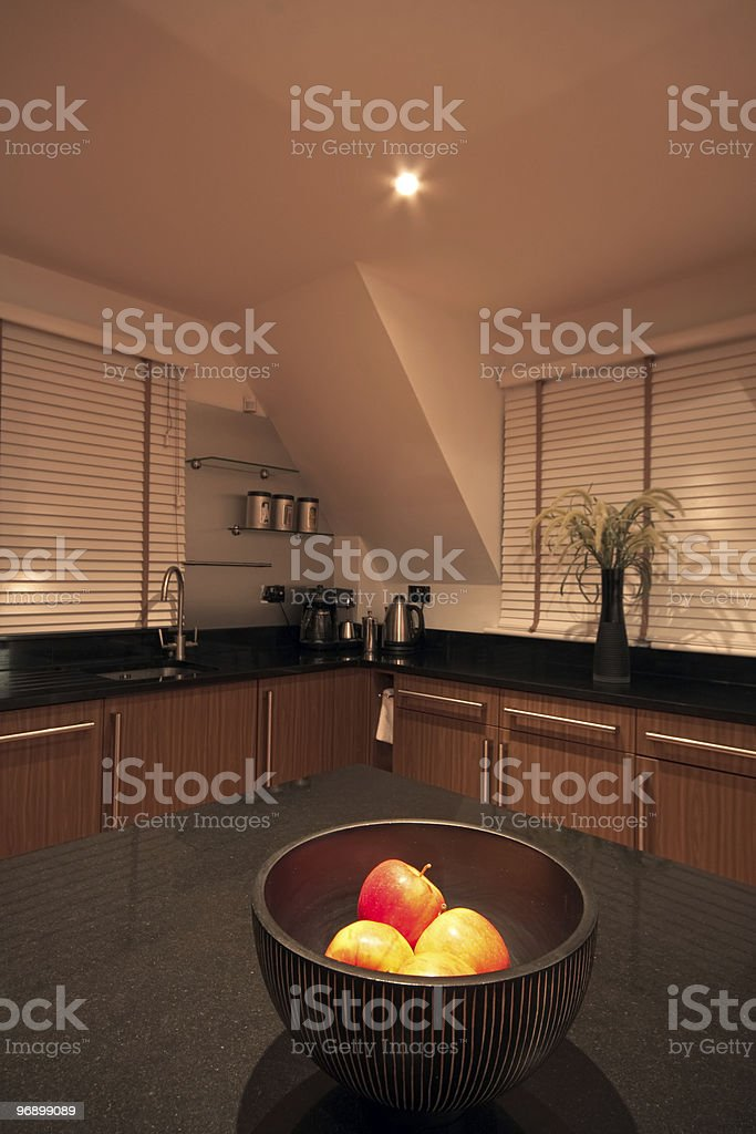 Fruit bowl with apples in a modern luxury kitchen royalty-free stock photo
