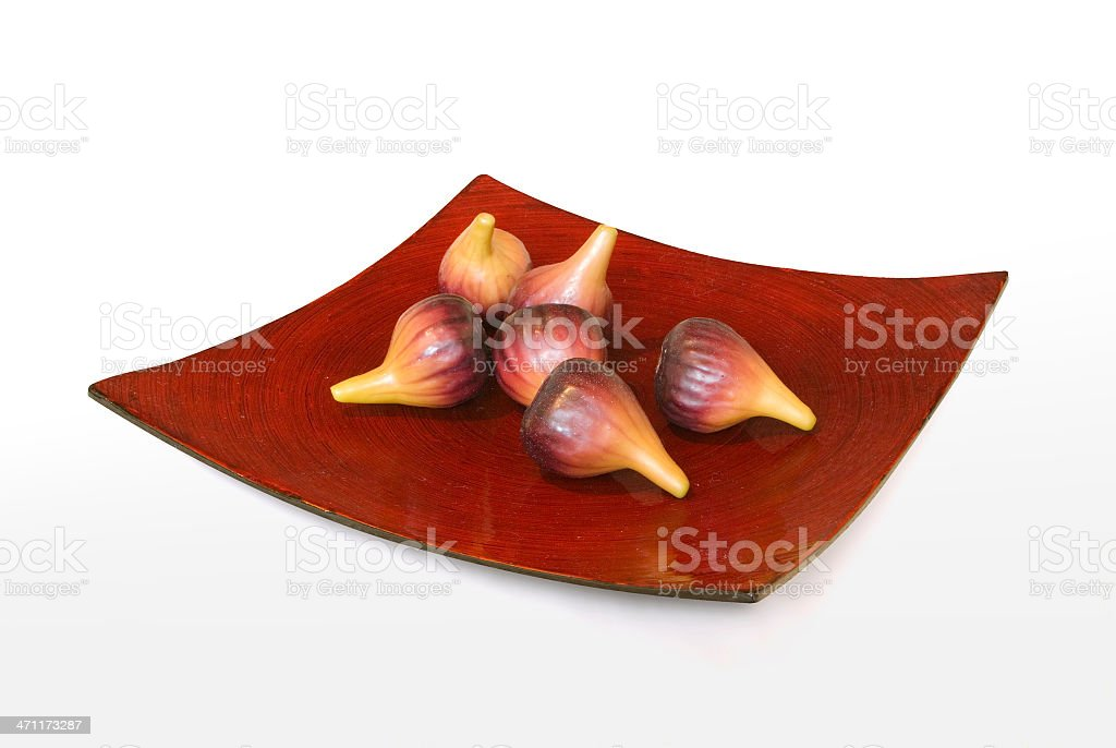 Fruit bowl with imitation figs (includes clipping path) stock photo
