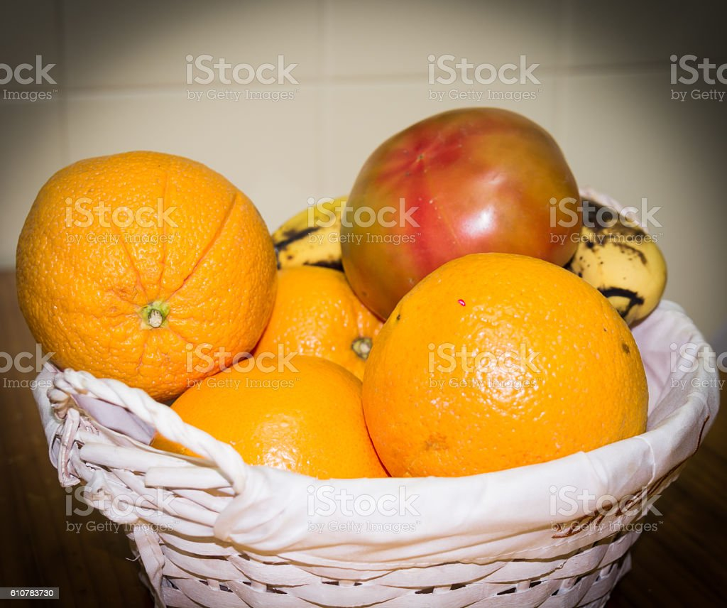 fruit bowl with oranges, toamtoes and bananas stock photo