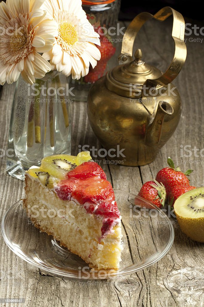 Fruit cake and teapot royalty-free stock photo