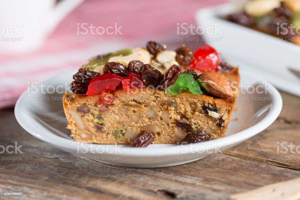 Fruit cake in white plate. stock photo