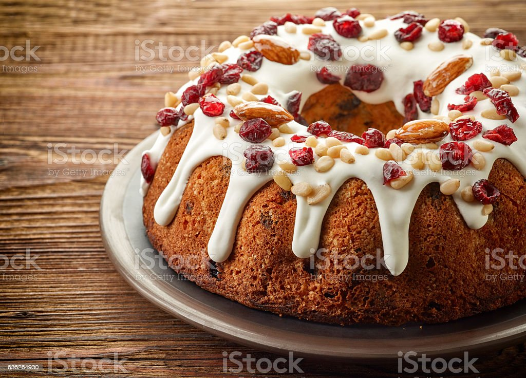 Fruit cake on wooden table stock photo