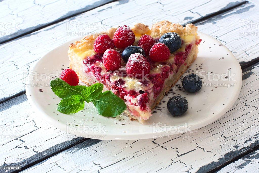 Fruit cake with fresh berries stock photo