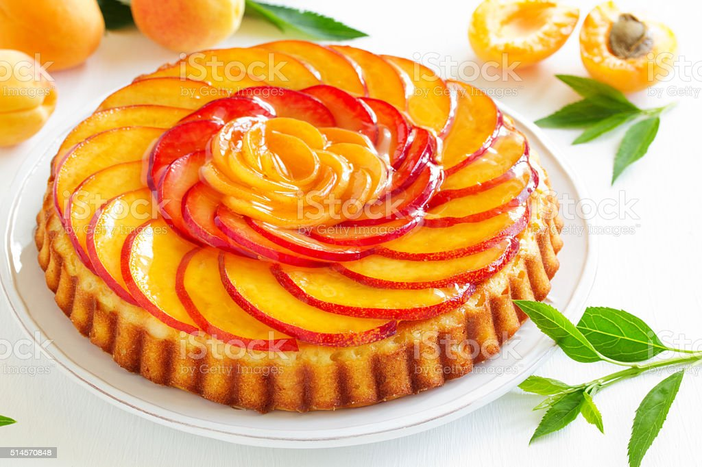 Fruit cake with peaches and ricotta. stock photo