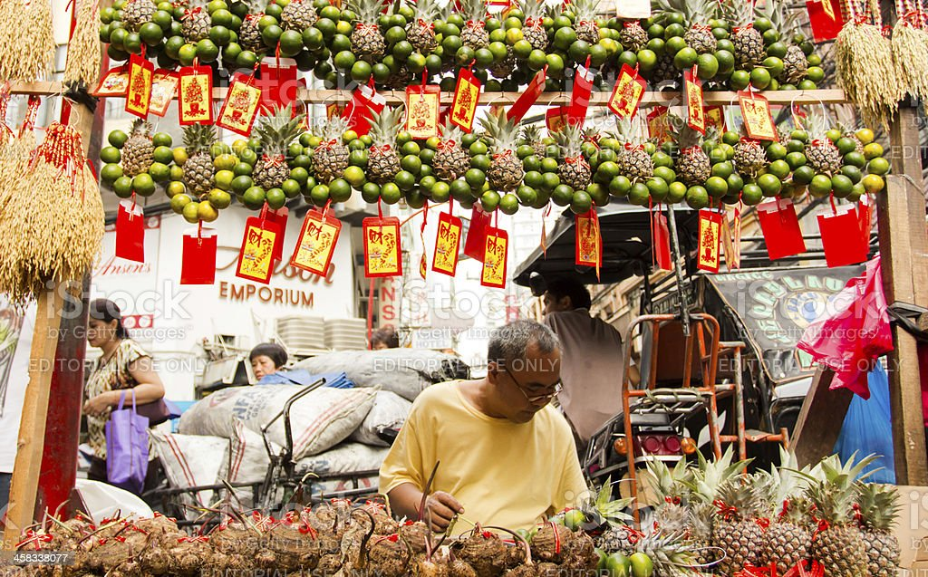 Fruit charm vendor in Chinatown stock photo