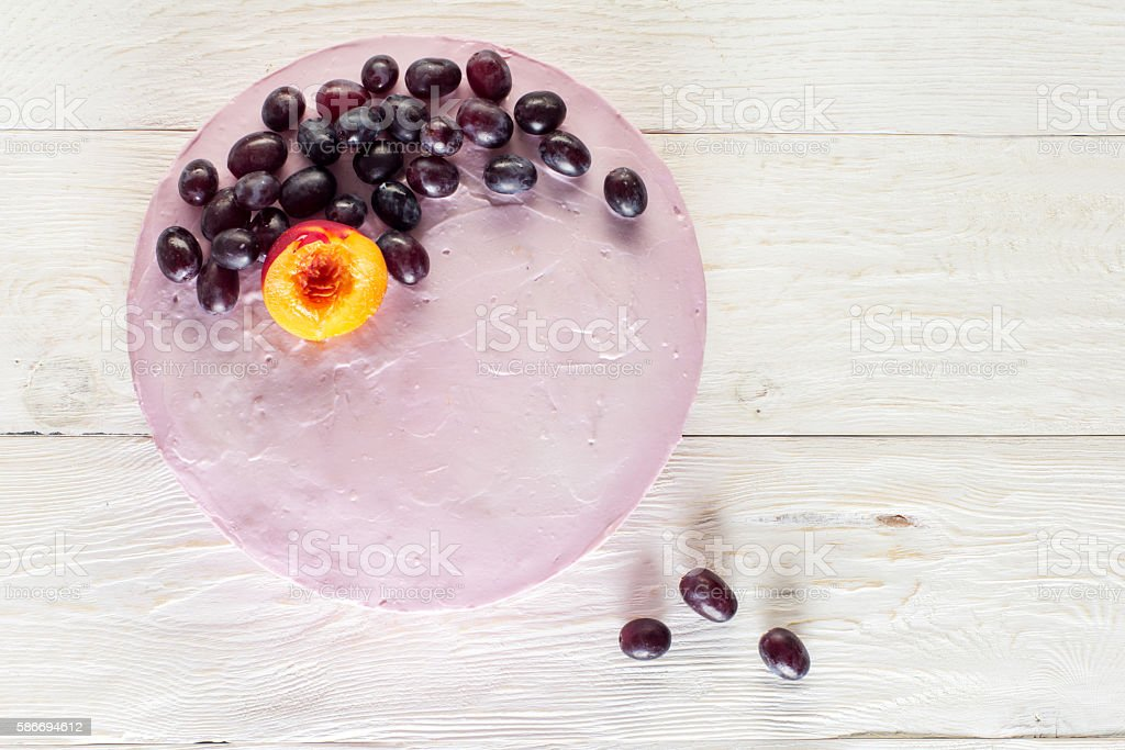 Fruit cheesecake decorated with grapes stock photo