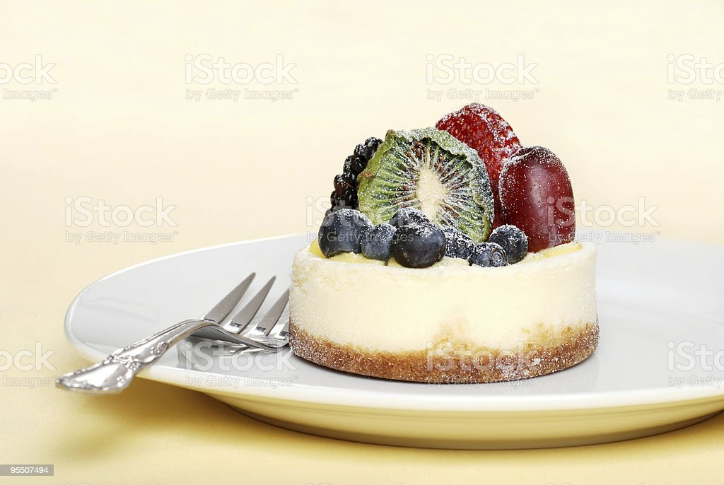 fruit cheesecake with a fork royalty-free stock photo