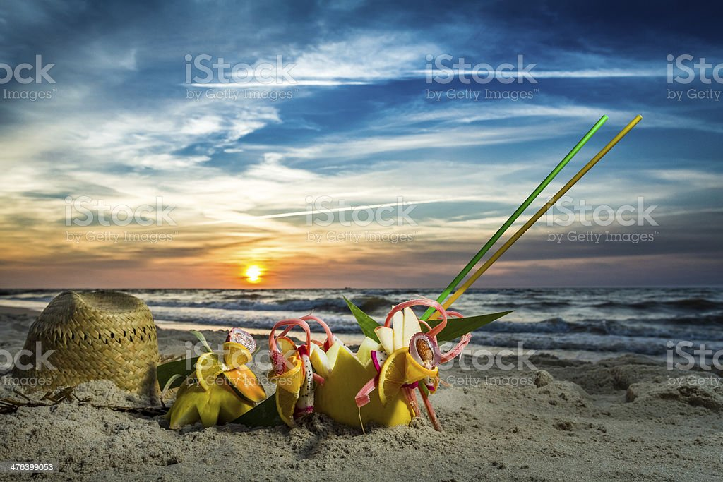Fruit cocktail on the beach at sunset royalty-free stock photo