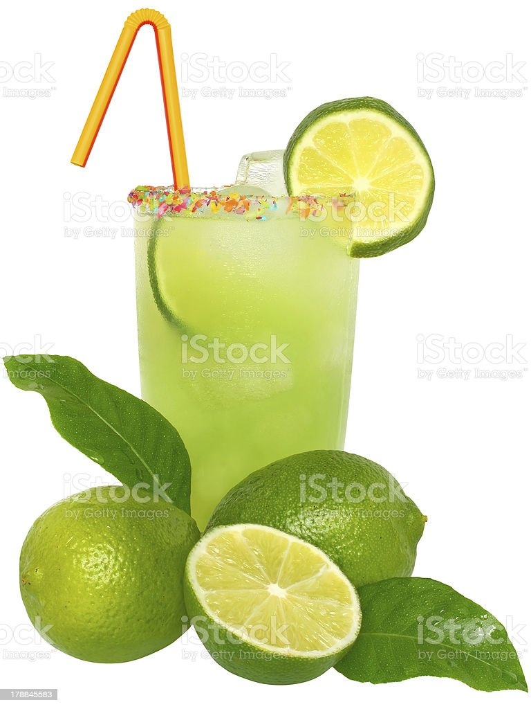 Fruit cocktail with lime and ice cubes in a glass. royalty-free stock photo