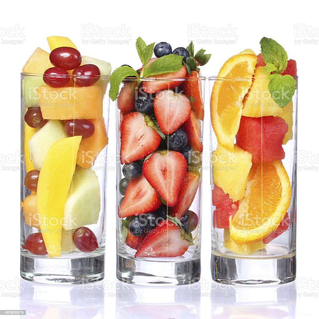 Fruit cocktails isolated. Fresh pieces of fruit in glasses stock photo
